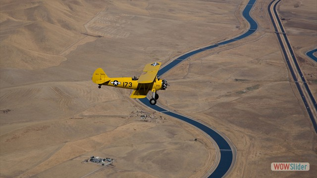 Stearman N54173 and Andreas Hotea cruising over Aquaduct in California